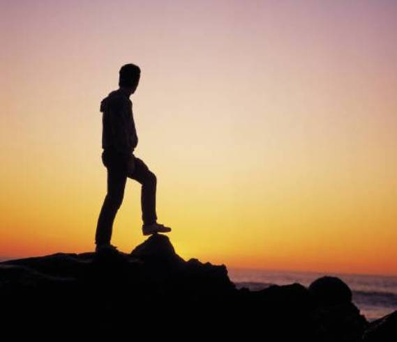 man-on-cliff-and-sunset-2