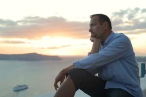 sad-man-looking-at-beautiful-sunset-over-island_4geswehpde__F0000