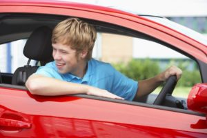teenage-boy-driving-red-car-760×506