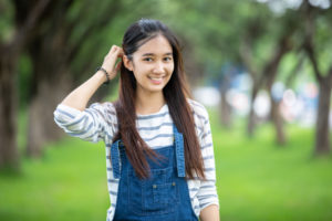 smiling-beautiful-asian-girl-tree-park-summer-relax-time_33718-1500